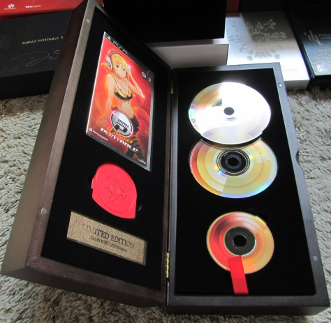 DJMax Hot Tunes LE. I decided to open up the box again since I had the game on my shelf for the longest time. I forgot how extravagant and over-the-top this design was.